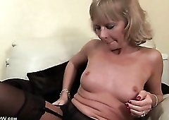 Mature blonde Cathy Oakley strips to black lingerie