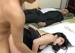 Stuffing her mouth with her panties and throbbing her pussy