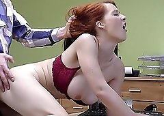 Busty redhead fucked from behind