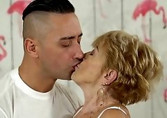 Granny takes a pounding and makes the young man cum