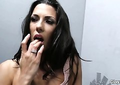 Stunning bronze skin brunette with sexy booty goes in the gloryhole room