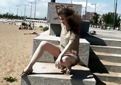 Hot and sexy young Russian girl flashes her pussy on the beach