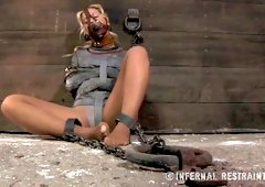 Chained blonde is sitting on the dirty cold floor