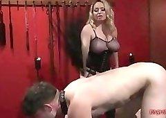 Busty blonde mistress spanks her slave