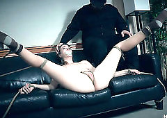 Horny master pours hot wax onto Ashley Lane's vulnerable body