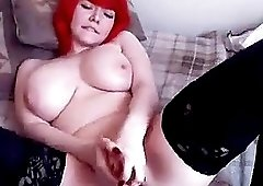 Webcam Teen with Red hair talks dirty in her bedroom