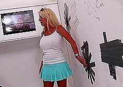 Blonde cougar Cammille Austin gets surprised with a dick in the glory hole