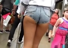 Sexy ass chick in tight jeans shorts
