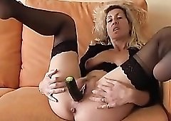 Milf shoves vegetables in her pussy
