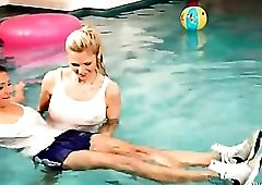 Sexy girls have clothed fun in the pool