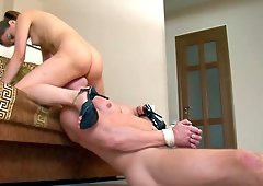 Cute babe with natural tits having her ass licked in femdom BDSM shoot