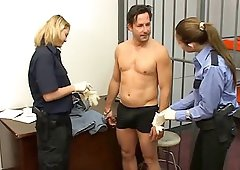 Horny and steamy guards give a prisoner a superb jerk off in the cell