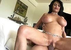 A big tits girl with black hair is giving a good blow job
