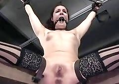 Bound and gagged babe Endza Adair toyed by master BDSM