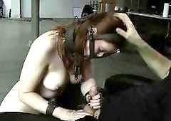Big breasted slave jerks off master while tied up BDSM
