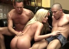 Two men are having their way with a hot blonde on the sofa