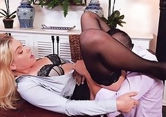 Giselle Palmer spreads her legs on a desk for a man's cock