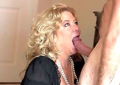 Horny granny is getting fucked by an old dude on the bed here