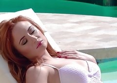 Redhead babe makes a long stiff dick disappear in her tight cunt