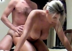 Big breasted milf has a guy plowing her snatch from behind