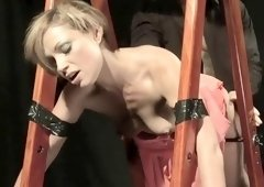 MILF slave is tied up to a sex swing and sucks his dick and gets hammered