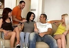 Naughty girls get together to fuck two hung studs