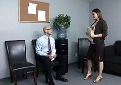 Two secretaries are pleasing their boss