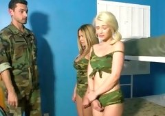Two girls get touched by a dude that has a soldier uniform on