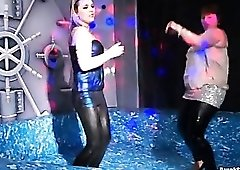 Curvy girls in wet look leggings dancing in club