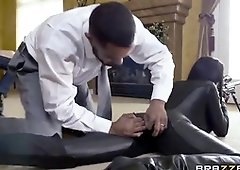 Romi Rain is dressed in a ebony, leather suit while getting humped rock-hard in the booty