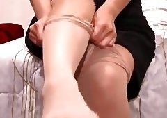 She puts on pantyhose and fingers a little!