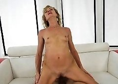 Wrinkly yet skinny blonde riding this dude's meaty cock