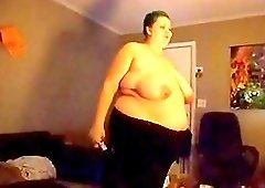 Big Fat wife in black pants playing and just dance