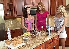 Colorfully dressed housewives licking pussy in the kitchen