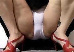 Sultry milf spreads her legs and reveals her white panties