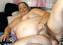 Bosomy huge bottomed fatty poses all naked on her bunk bed on webcam